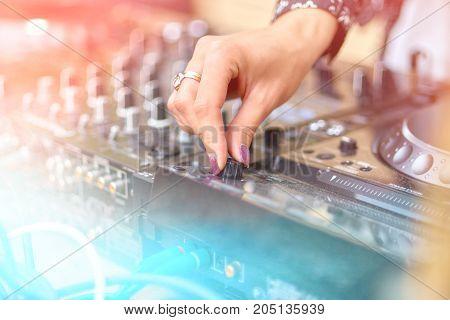 DJ hands on the remote. Light Lights.