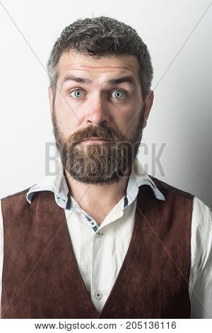 Man With Long Beard And Mustache On Surprised Face.