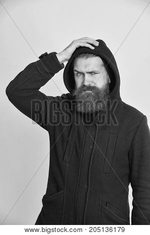 Bearded Serious Brutal Caucasian Man In Black Jacket And Hood