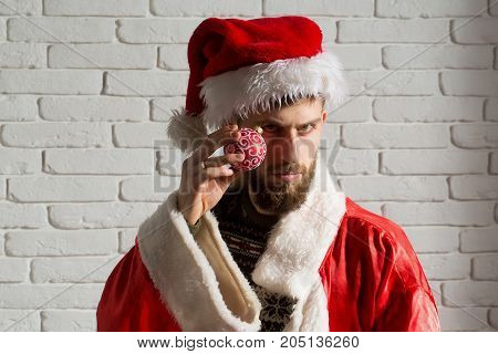 Christmas Man In Santa Claus Hat Hold Decoration Toy