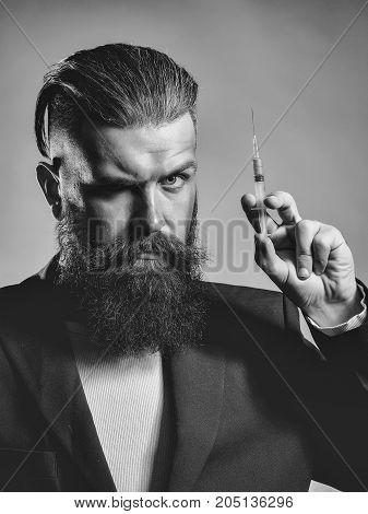 Bearded Man With Syringe
