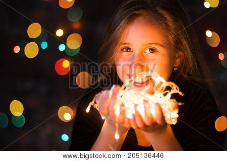 Beautiful Teenage Girl Holding Festive Lights