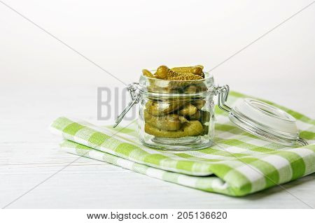 Pickled delicious cucumbers. The concept is healthy food vegetarianism.