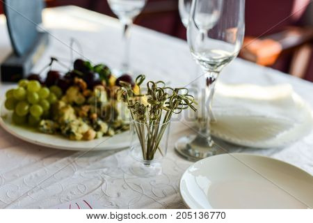 buffet table, Canape, sandwiches, snacks, holiday table, sliced, glasses celebration new year christmas fourchette catering table setting