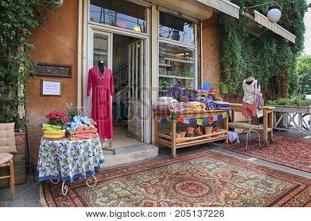 TEL AVIV-YAFO, ISRAEL - APRIL 5, 2016: Designer clothing shop at Jaffa flea market area of Tel Aviv, Israel. Jaffa flea market is one of the popular attractions for tourists and locals.
