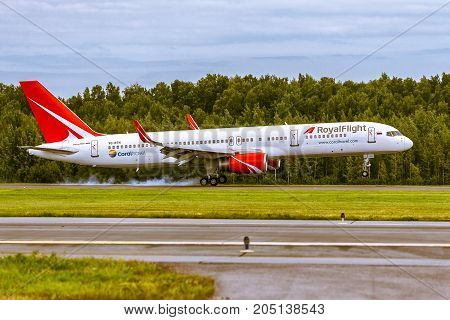 Pulkovo, Saint-Petersburg, Russia - August 10, 2017:   The airplane  Boeing B757 of RoyalFlight airlines is landing on the runway against the background of the forest