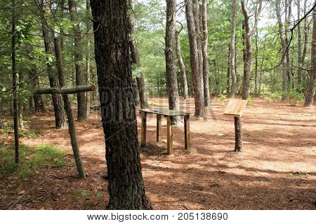 Wooden cross, altar and lectern in the forest for holding outdoor mass
