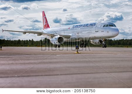 Pulkovo, Saint-Petersburg, Russia - August 10, 2017:   The airplane Airbus A321 of Turkish airlines is moving on the runway against the background of the forest and blue cloud sky. Summer sunny weather