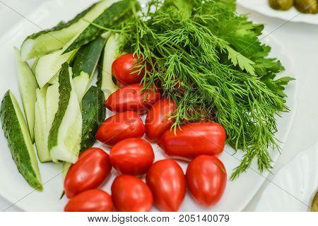 ripe fresh vegetables close-up. horizontal photo. tomatoes cucumbers onion