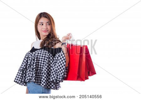 Happy Excited Woman Standing And Holding Colorful Shopping Bags Isolated On A White Background.