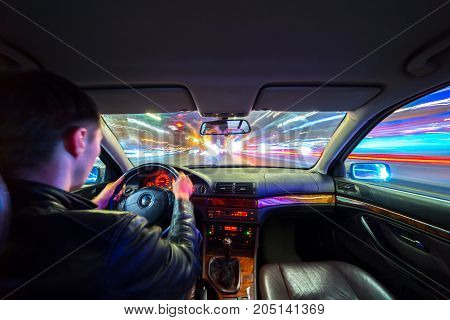 Driver In Car Moves At Fast Speed At Night.