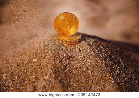 Bitcoin. Image of icon bitcoin on golden sand, in background sea. Concept freelance, stock exchange.