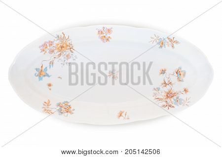 Antique decorated porcelain long plate isolated on white with clipping path. Porcelain factory of Kornilov brothers end of 19th century St Petersburg. New rococo decal