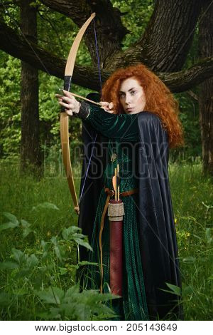 Red Haired Girl Shoots From The Bow