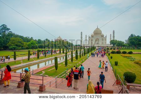 Agra, India - September 20, 2017: Unidentified people walking and enjoying the beautiful Taj Mahal, is an ivory-white marble mausoleum on the south bank of the Yamuna river in the Indian city of Agra, Uttar Pradesh, in India.