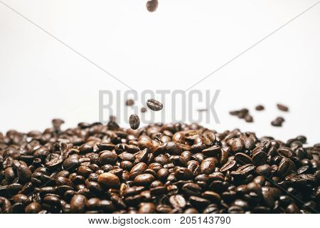 Roasted coffee beans isolated on white falling