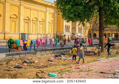 JAIPUR, INDIA - SEPTEMBER 19, 2017: Unidentified people dry their clothes near of the City Palace, a palace complex in Jaipur, Rajasthan, India.