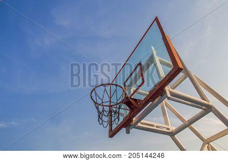 Photo of glass basketball hoop and blue sky backgroundbasketball basket