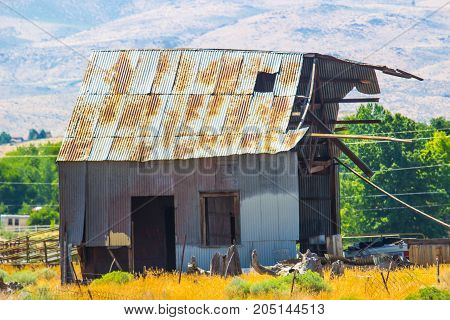 Abandoned Rusty Tin Roof Building In Need Of Major Repairs