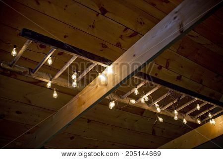 A rustic ladder and light home fixture.