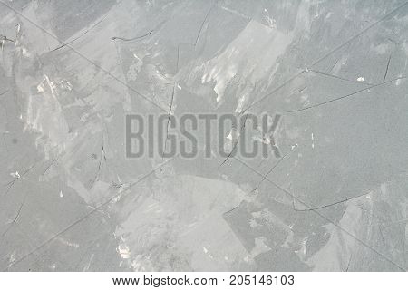 Modern homemade gray texture imitating concrete. Background.