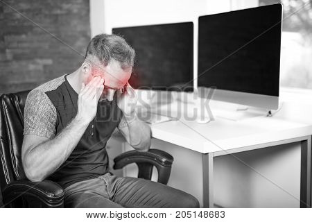 A Young business man with problems and stress in the office