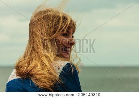 Girl Enjoying Summer Breeze By Seaside