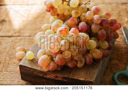 Brunch Of Fresh Ripe Grape On A Wooden Background. Close Up.