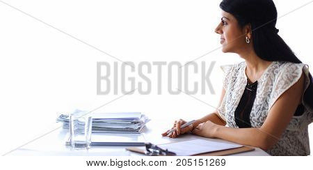 Woman with documents sitting on the desk, in office