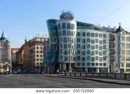PRAGUE CZECH REPUBLIC - FEBRUARY 01 2014: A modern landmark in Prague Dancing House or Fred and Ginger. Architects Vlado Milunic and Frank Gehry.