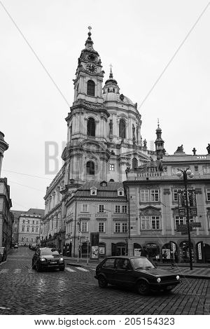 PRAGUE CZECH REPUBLIC - FEBRUARY 02 2014: The streets of old Prague. Saint Nicholas Cathedral. Stylized film. Large grains. Black and white