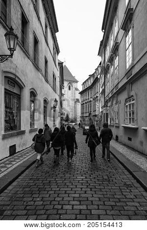 PRAGUE CZECH REPUBLIC - FEBRUARY 02 2014: The streets of old Prague. Stylized film. Large grains. Black and white. Prague is the capital and largest city of the Czech Republic