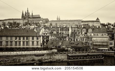 PRAGUE CZECH REPUBLIC - FEBRUARY 02 2014: View of old Prague and St. Vitus Cathedral. Sepia. Stylized film. Large grains