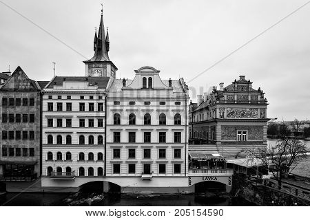 PRAGUE CZECH REPUBLIC - FEBRUARY 02 2014: House of old Prague and Vltava river. Black and White. Stylized film. Large grains.