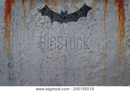Bloody wall with bat silhouette. Copy space for text. Halloween poster concept and invitation card template.