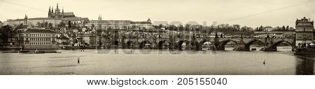 PRAGUE CZECH REPUBLIC - FEBRUARY 02 2014: Panoramic view of old Prague Charles Bridge and St. Vitus Cathedral. Sepia. Stylized.