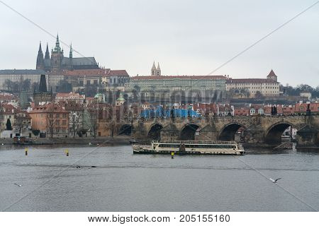 PRAGUE CZECH REPUBLIC - FEBRUARY 02 2014: View of old Prague Charles Bridge and St. Vitus Cathedral