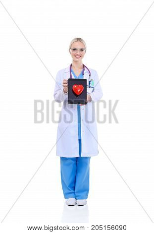 Young woman doctor holding a red heart, isolated on white background. Woman doctor.