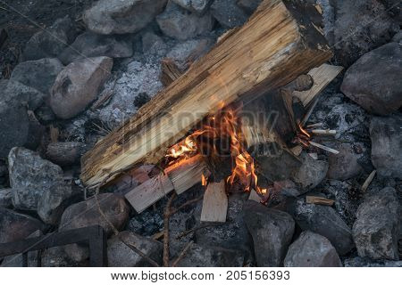 Bonfire in a stone fireplace at evening