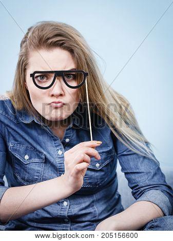 Happy Woman Holding Fake Eyeglasses On Stick