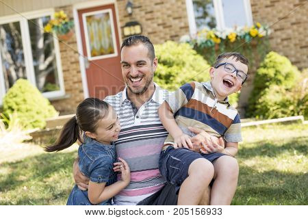 A Portrait of happy family in front of house