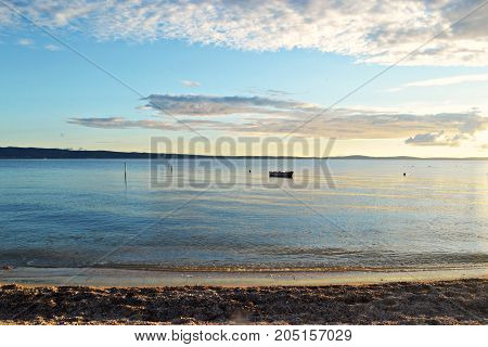 Panoramic sea view whit a boat in the calm sea