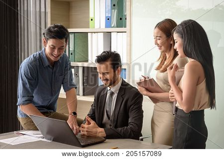 young businesspeople man and woman look at laptop for business project in the meeting