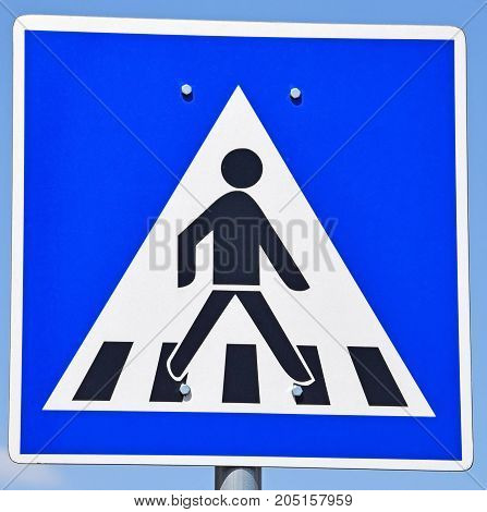 Pedestrian crossing road sign on the street