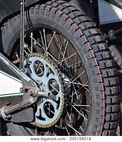 Tire of a motorcycle with chain closeup