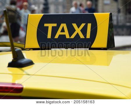Taxi sign of a taxi car closeup
