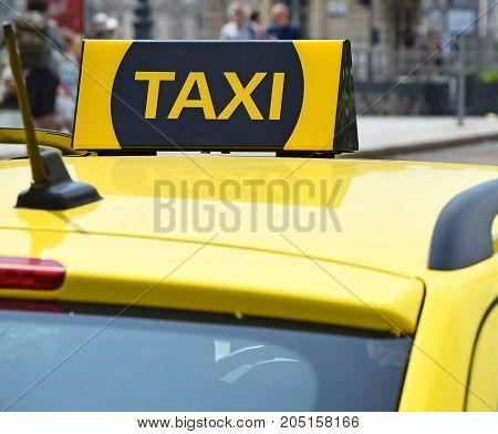 Taxi sign closeup of a taxi car