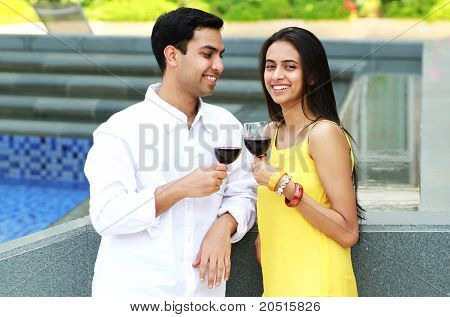 Young Romantic Couple Celebrating With Wine.