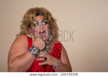 Funny travesty actor. Drag queen. Fat man and make-up.