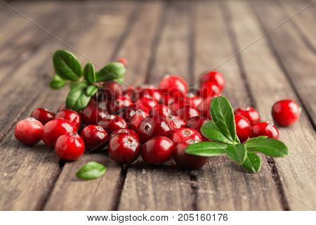 Fresh Autumn Berries Cranberries Over Brown Wooden Table With Leaves
